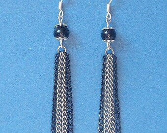 Earrings black and silver mounting
