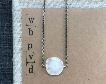 solar quartz pendant necklace.