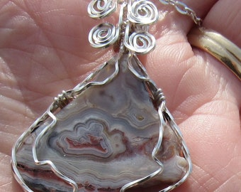 Crazy Lace Agate Cabochon wire wrapped pendant in Argentium  Sterling Silver
