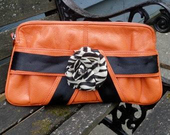 Orange Clutch with Zebra Print Flower