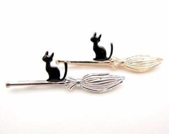 black cat and magic broom