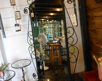 Wrought iron mirror, bevelled glass