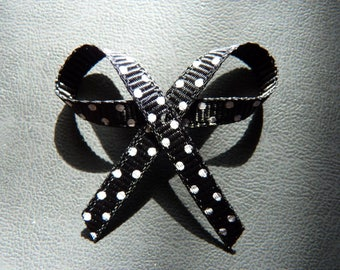 Pretty bow with black decorated with Ribbon