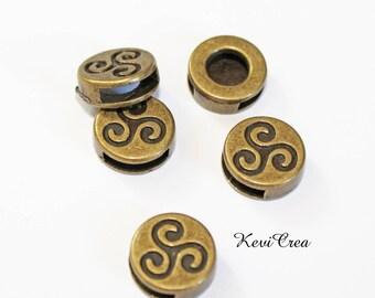 2 x beads passing pattern triskel brass