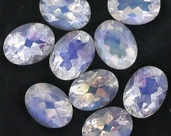 one 8x6 oval faceted rainbow moonstone gemstone gem