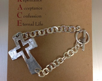 Silver cross bracelet with toggle clasp