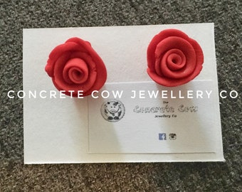 Dainty red vintage rose stud earrings on a silver plated stud back