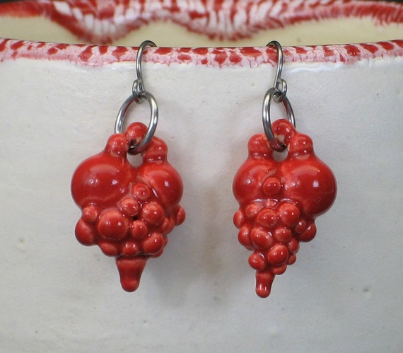 set of two neon red ball heart earrings