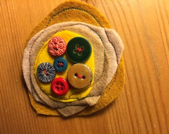 Wool felt designer brooch with a selection of buttons