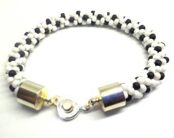 White and black daisy  beaded bracelet woven on a Kumihimo braid