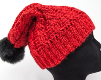 Cabled slouchy hat with faux fur pom