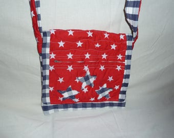 Red, blue and white quilted messenger bag.