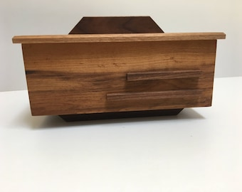 This handsome little box is made from cherry and walnut and has two compartments for rings and earings.