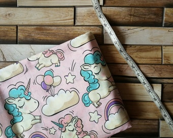 Cotton unicorns with balloons on pink background, cotton fabric for kids babys