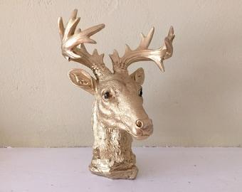 faux deer head, deer bust,  table top, very detailed, gold