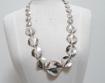 Wavy sterling silver discs necklace.