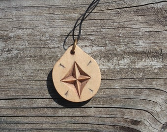 Hand carved star necklace