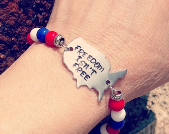 Freedom Isnt Free Bracelet helps provide service dogs to military veterans soldiers USA United States America red white blue druk