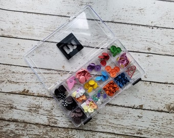 18 cube Making Memories embellishment case full of brads, buttons and clips (#5)