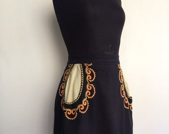 Very cute folklore vintage black half apron with embroidery