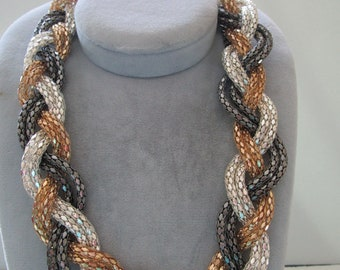One Braided Necklace in Silver, Gold, Black Chains