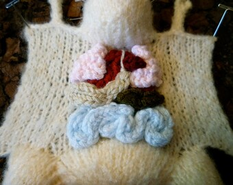 VEGAN Knitted Lab Rat, dark cork background