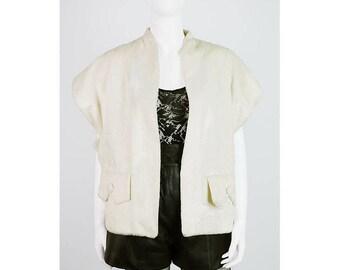 Shimmering vintage faux fur vest in cream