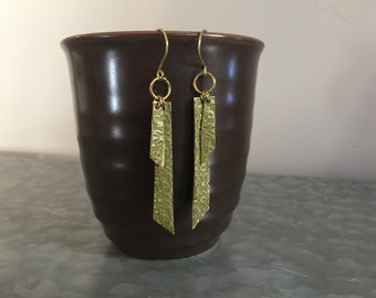 Stamped brass earrings with olive green patina.