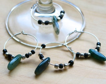 Wine Charms featuring green gemstones