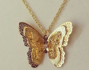 Gold plated 3D butterfly necklace with diamond center