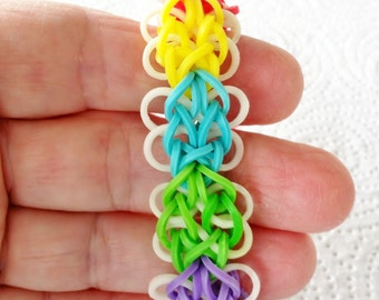 RAINBOW LOOM Bracelet In Sweet Butterfly Design.  This is For A Child, and Has an Extension In the Back.  Beautiful Colors.