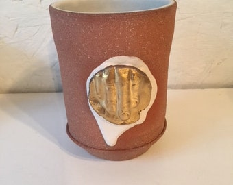 Brown Cup with White Slip and Gold Fingers Medallion