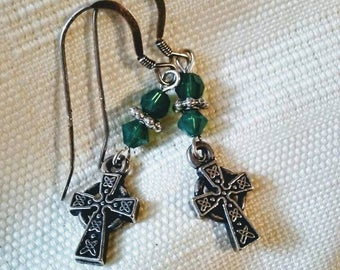 Green and silver pierced earrings with Celtic Cross charms.