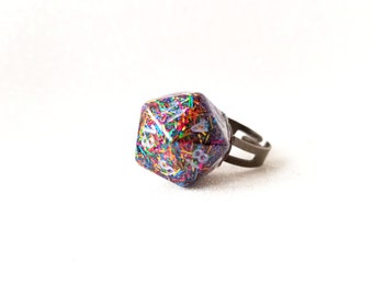 Individually cast clear resin D20 dice ring with rainbow tinsel glitter