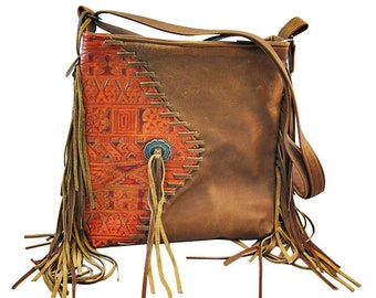 Western leather crossover bag.   Embossed leather.  Made in USA, adjustable strap