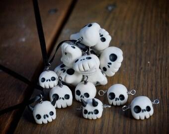 Handmade, porcelain high fire Skull beads