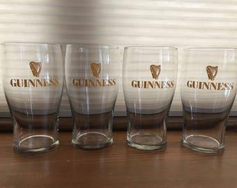 Four Guinness pint glasses