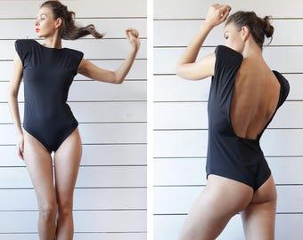 Vintage black large enhanced shoulders cut out back backless simple fitted gymnastics underwear leotard bodysuit L