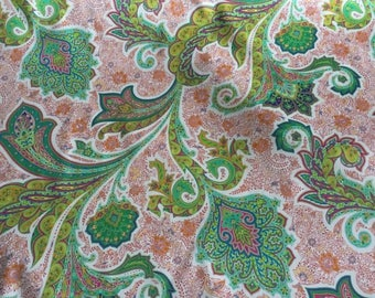 Cotton Sateen with Stretch, with a beautiful Paisley print of Greens, Yellows, Orange, Pinks and Reds, Made in Italy, Price is per Yard