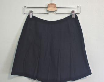 Pleated linen mini skirt
