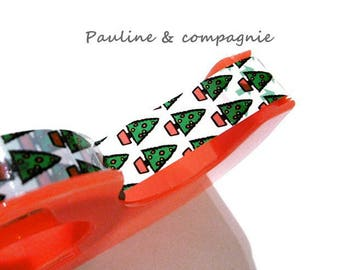 A roll of scotch masking tape with dispenser Christmas tree pattern