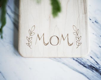 "Mother's Day Gift -  Cutting Board ""MOM"" Engraved Small Maple Wood Cutting Board with Handle, Wood Serving Board, Paddle Board"