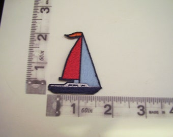 Red and blue sailboat iron on patch