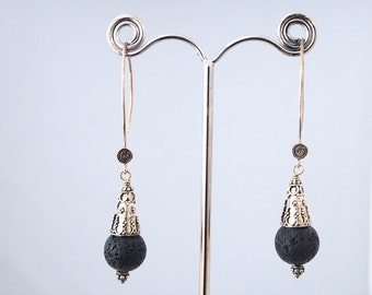 Silver earrings and pearl of lava