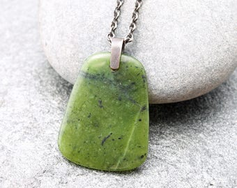 Canadian nephrite jade donut pendant on leather cord nephrite