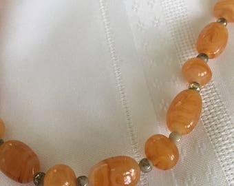 Orange and Amber with Swirls of Cream Glass Beaded Necklace with Gold Accents