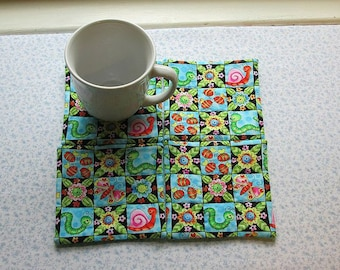 snails caterpillars and butterflies hand quilted set of mug rugs coasters