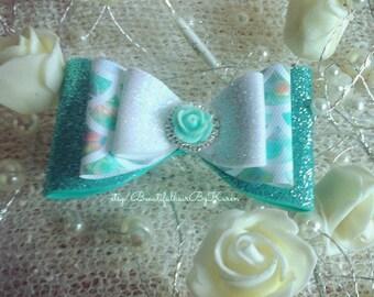 4 inch aqua glitter mermaid scale now with diamante bow embellishment