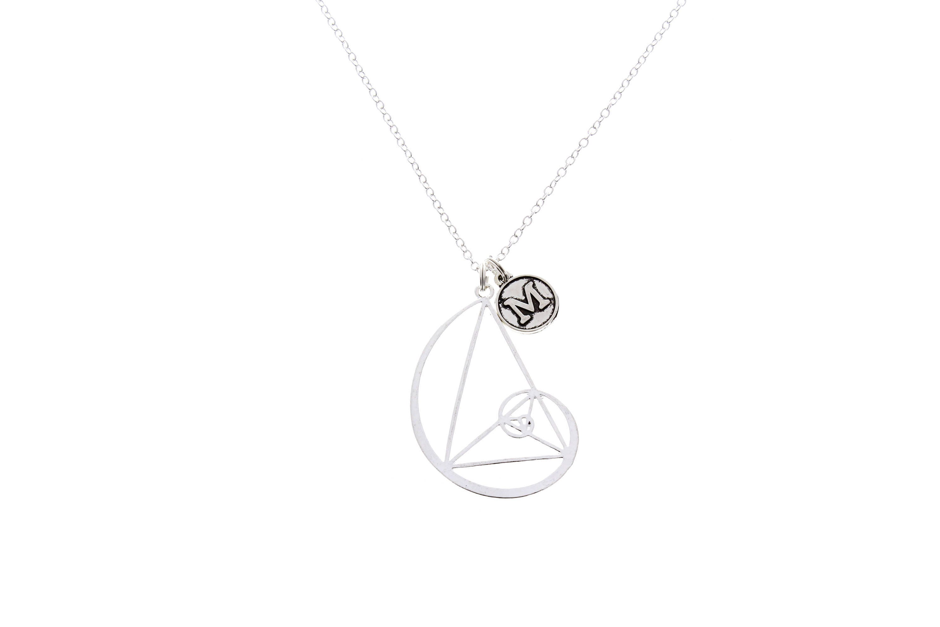 necklace hangs products a from golden beautifully silver ratio image on interlinked sacred geometry sterling chain with symbols handcrafted