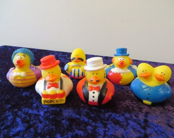 Circus/Carnival rubber ducks.Two-headed duck; a clown, a strong man, a popcorn vendor, and a ring master